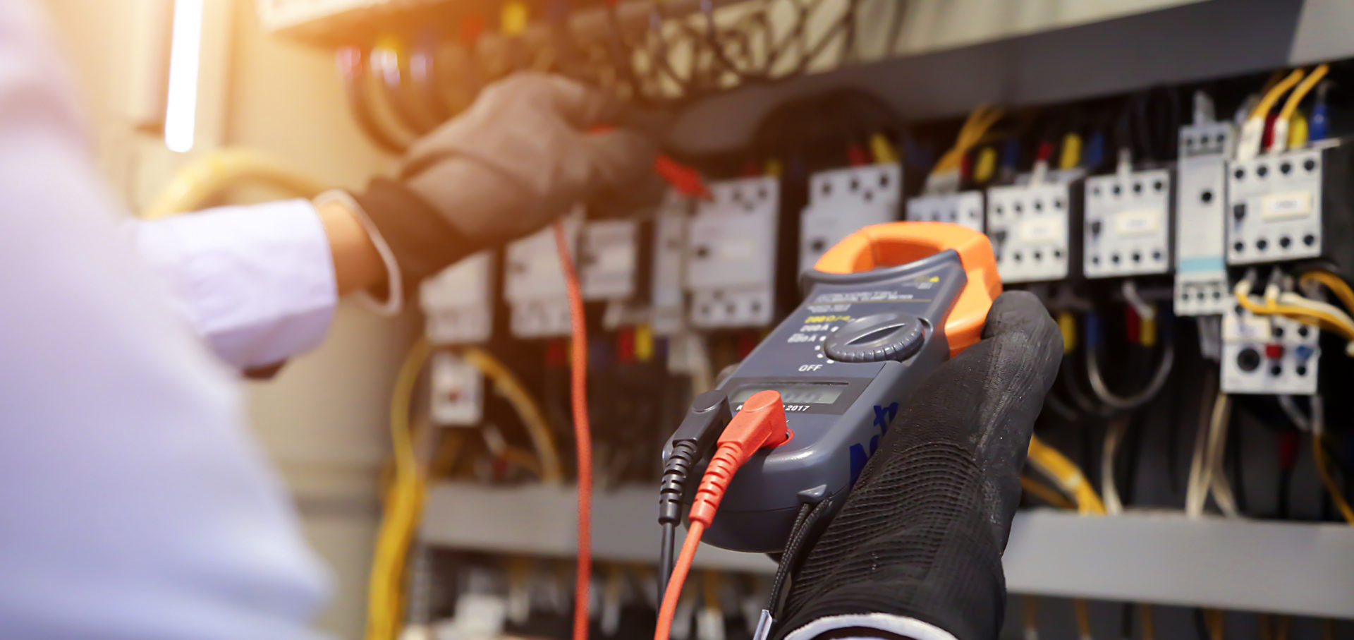 Electrician checking voltage